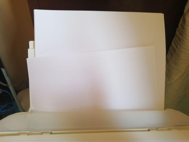 打印机进纸到这里就卡住,同时缺纸指示灯闪烁