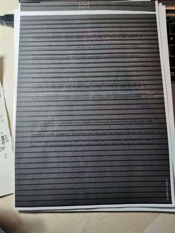 我复印的纯黑页面,盖子合不上所以有一条一条的。但明显没有空行